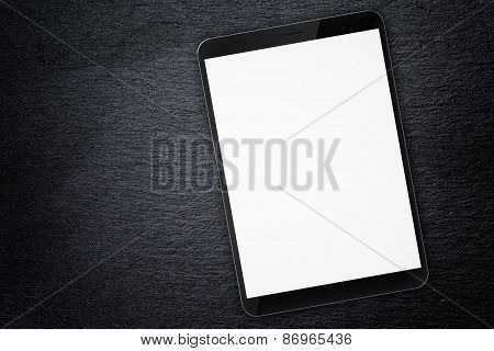generic tablet pc on top of slate board