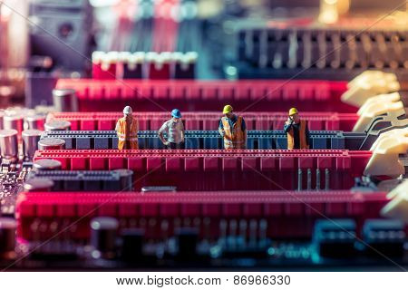 Miniature Engineers Repairing Circuit Board. Technology Concept