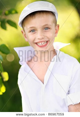 Portrait Of A Boy On Vacation In Summer Camp