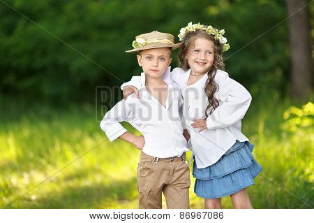 Portrait Of A Boy And Girl In Summer