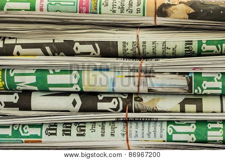 Row Of Newspapers On White