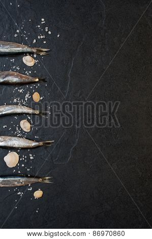 Small Fishes With Salt On The Table