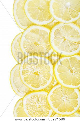 Background Of Heap Fresh Yellow Lemon Slices Isolated