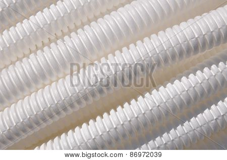 White plastic corrugated pipe as background