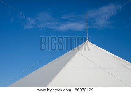 The Upper Part Of The Tent Against The Blue Sky