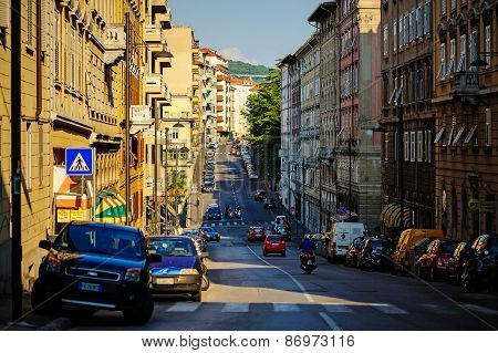TRIESTE, ITALY - 20 JULY 2013: street view with cars in summer