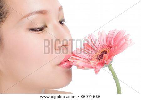 Beautiful Young Woman Kiss And Pink Gerbera