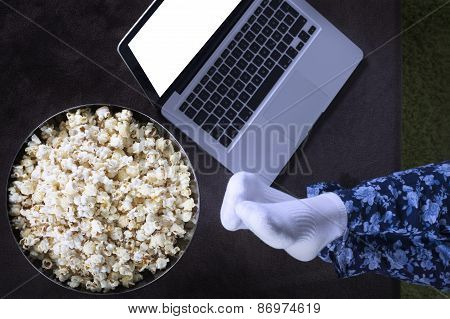 watching movie online at home with popcorn