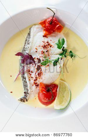 Chilean seabass fillet in plate, vertical shot