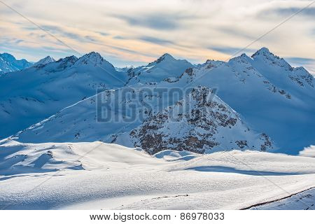 Snowy Blue Mountains In Clouds