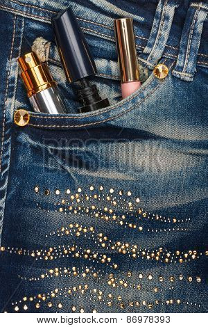 Cosmetics Sticks Out Of The Pocket Of His Jeans With Rhinestones