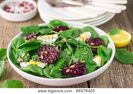 Fresh spinach salad, eggs and roasted beets