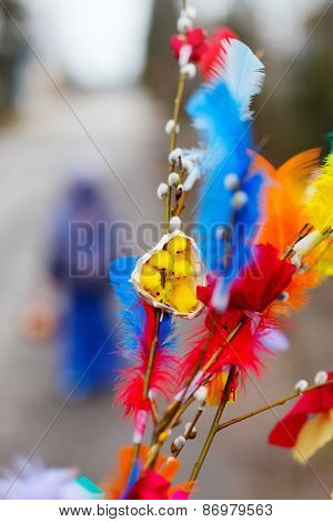 Pussy willow branches decorated with colorful feathers for Easter palm Sunday traditional celebration in Finland