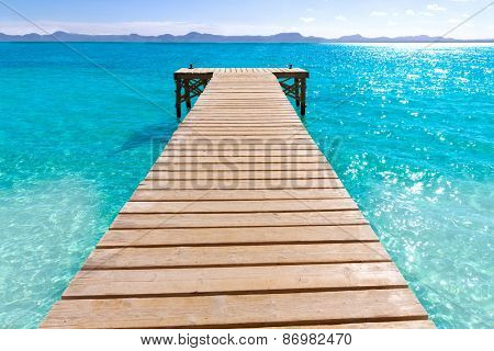 Platja de Alcudia beach pier in Mallorca Majorca at Balearic islands of Spain