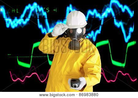 man in hard hat and gas mask - Sound engineer or scientist in front of Multicolored Electric Oscilloscope traces to music