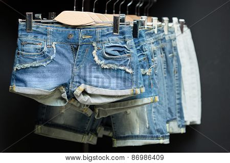 blue denim shorts on a hanger