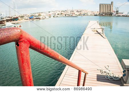 Red Railing At The Pier