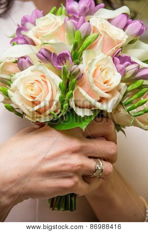 Bouquet Of Roses And Freesias In The Hands Of The Bride