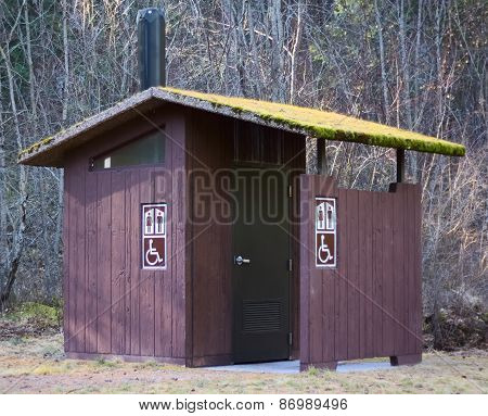 Old Outhouse with Moss in the Forest