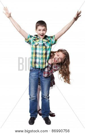 Boy with raised hands in colorful shirt and peeps girl isolated on white