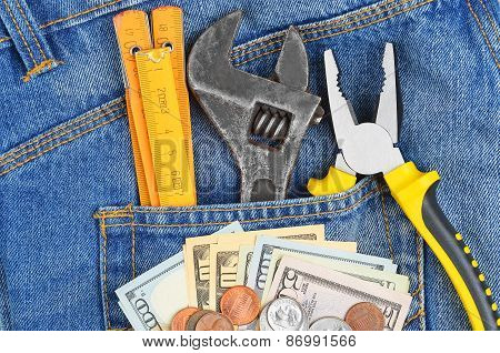 Money and tool in jeans pocket
