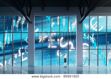 Businesswoman Looking Through The Window In Office