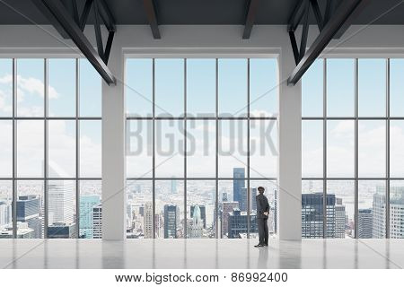 Businessman Looking Through The Window In Office