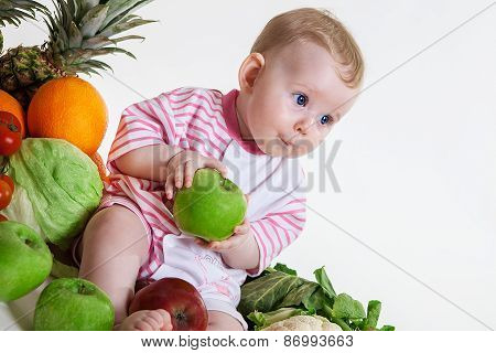 Cute baby sitting with fruits and vegetables