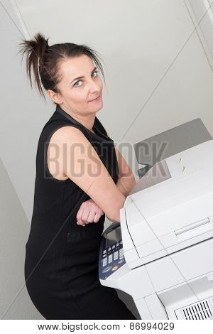 Woman with a copy machine