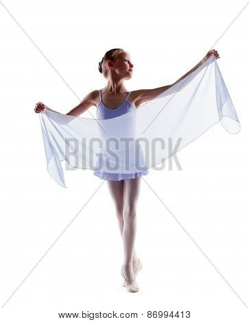 Adorable little ballerina dancing with cloth