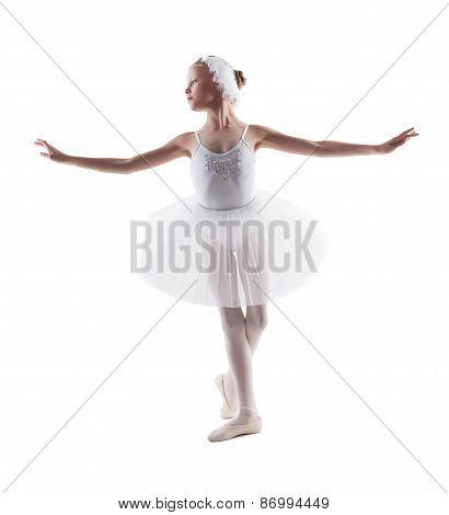 Cute little ballerina dancing role of white swan