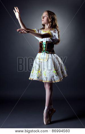 Image of curly ballerina posing in folk dress