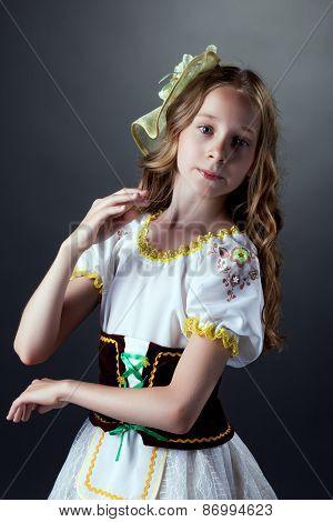Portrait of cute gray-eyed dancer in folk dress