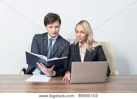 Two Young Business Partners At Meeting