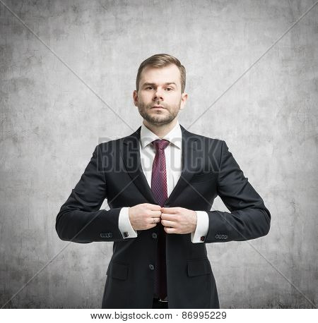 Businessman Standing In Front Of The Concrete Wall
