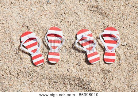Two Pairs Of Striped Flip-flops