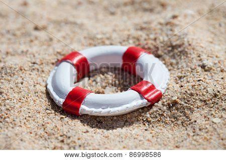 Miniature Lifebuoy On Sand