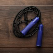 stock photo of skipping rope  - skipping rope for an exercise on the table - JPG