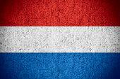 stock photo of holland flag  - flag of Holland or Dutch banner on rough pattern texture the Netherlands - JPG