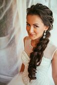 stock photo of panty-hose  - Beautiful young bride with wedding makeup and hairstyle in bedroom newlywed woman final preparation for wedding - JPG