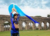 pic of aqueduct  - blue belly dancer under the Roman aqueduct - JPG