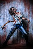stock photo of bloody  - Scary bloody zombie girl with an ax - JPG