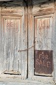 "picture of crunch  - ""For sale"" handwriten on a derelict door a real estate crunch concept - JPG"