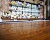 foto of wooden table  - Top wooden table with Bar Blurred Background - JPG
