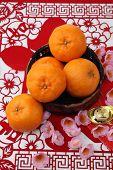 foto of mandarin orange  - mandarin oranges on the red paper cutting - JPG