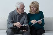 picture of budget  - Old couple analyzing home budget and counting money - JPG