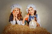 foto of rabbit year  - girl with a rabbit on the hay and a carrot - JPG