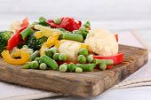 picture of cutting board  - Frozen vegetables on cutting board - JPG