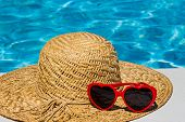 stock photo of relaxation  - utensils for a nice relaxing vacation day lying next to a swimming pool - JPG