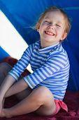 image of cabana  - Little girl at luxury resort relaxing at beach cabana - JPG